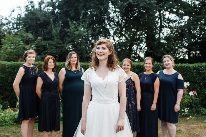 Bride In Homemade Dress And Bridesmaids