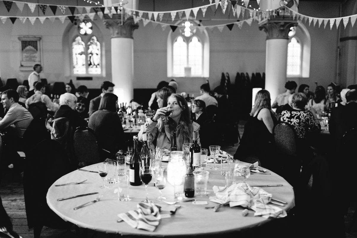 Guest waiting and drinking wine at wedding breakfast table in Bristol