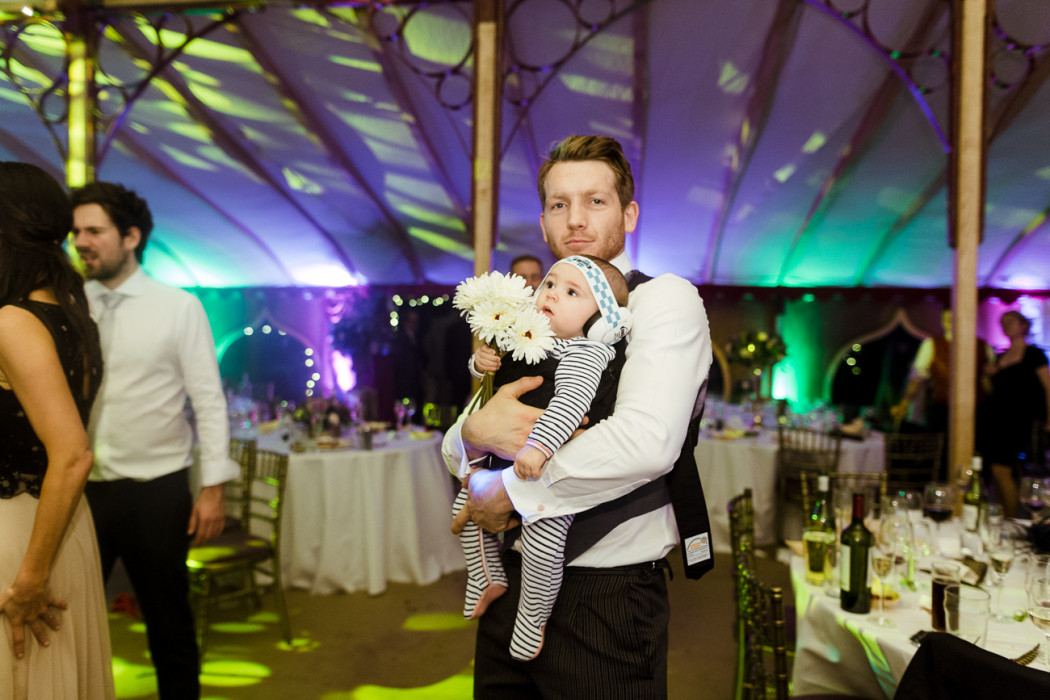 baby and dad at wedding