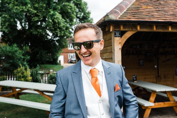 Groom At Pub In Cobham Before Wedding In Orange Tie
