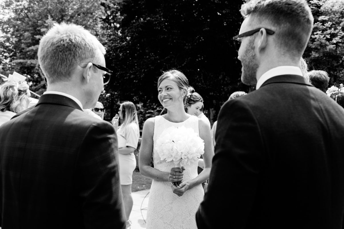 candid photograph of bride smiling at Houchins wedding venue in essex