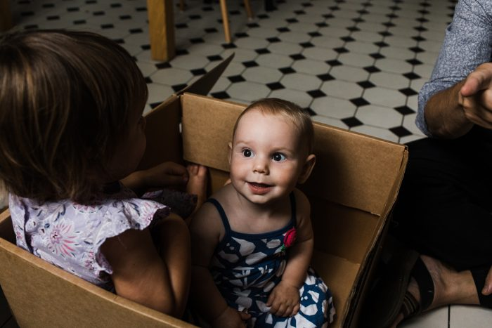 lifestyle family photography style portrait of a baby in a box